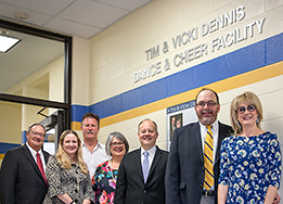 Tim and Vicki Dennis pose with the School Board in front of their naming plaque.